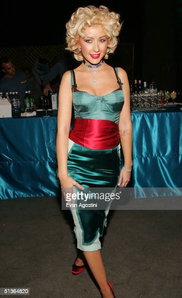 """Singer Christina Aguilera attends the """"Shark Tale"""" premiere at Central Park's Delacorte Theater on September 27, 2004 in New York City, New York."""
