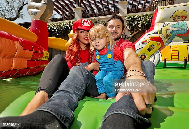 Singer Christina Aguilera daughter Summer Rain Rutler and Matthew Rutler pose in the bouncy house during the second birthday party for Christina...
