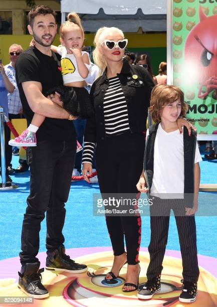 Singer Christina Aguilera Matthew Rutler Max Liron Bratman and Summer Rain Rutler arrive at the premiere of 'The Emoji Movie' at Regency Village...