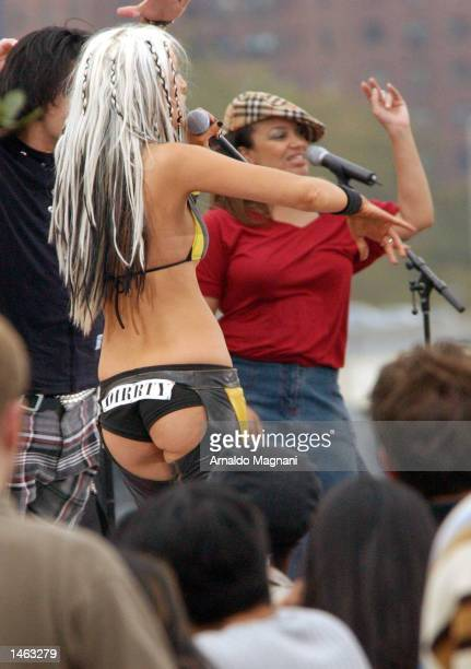 Singer Christina Aguilera performs at an MTV production October 7 2002 underneath the Brooklyn Bridge in New York City