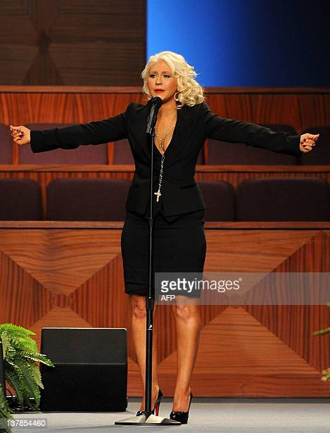 Singer Christina Aguilera performs at the Etta James' funeral 2012 in Gardena California on January 28 2012 AFP PHOTO/VALERIE MACON