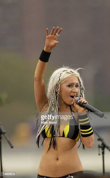 Singer Christina Aguilera performs for 'TRL Presents Christina Stripped in NYC 2002 at Brooklyn Bridge' October 7 2002 at Empire Fulton State Park in...