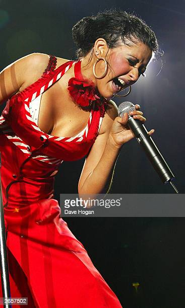 Singer Christina Aguilera performs onstage during the Stripped European tour at the NEC Arena on October 25 2003 in Birmingham England