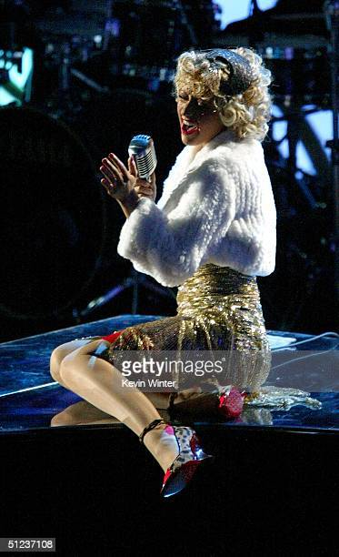 Singer Christina Aguilera performs Tilt Ya Head Back at the 2004 MTV Video Music Awards at the American Airlines Arena August 29 2004 in Miami Florida