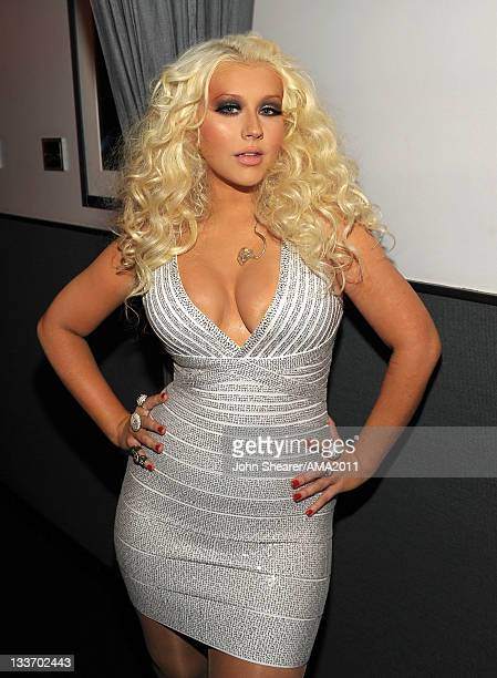 Singer Christina Aguilera poses backstage at the 2011 American Music Awards held at Nokia Theatre LA LIVE on November 20 2011 in Los Angeles...