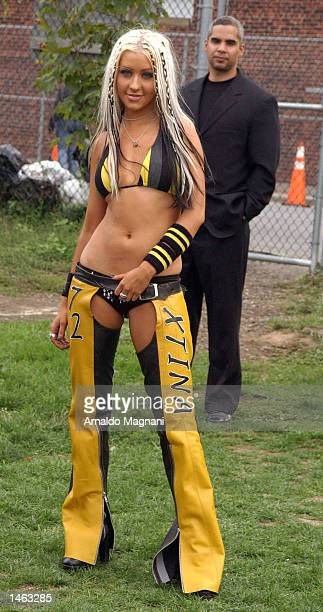 Singer Christina Aguilera poses prior to a performance at an MTV production October 7 2002 underneath the Brooklyn Bridge in New York City