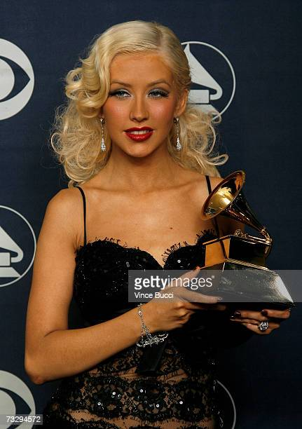 Singer Christina Aguilera poses with her Grammy for Best Female Pop Vocal Performance for 'Ain't No Other Man' in the press room at the 49th Annual...