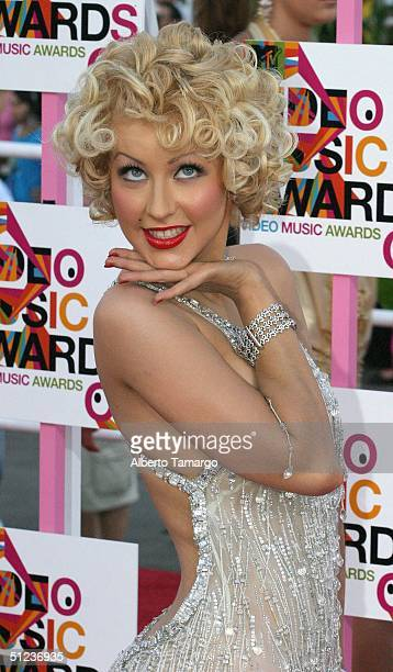 Singer Christina Aguilera wearing Roberto Cavalli arrives at the 2004 MTV Video Music Awards at the American Airlines Arena August 29 2004 in Miami...