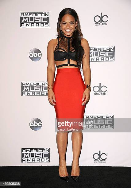 Singer Christina Milian poses in the press room at the 2014 American Music Awards at Nokia Theatre LA Live on November 23 2014 in Los Angeles...