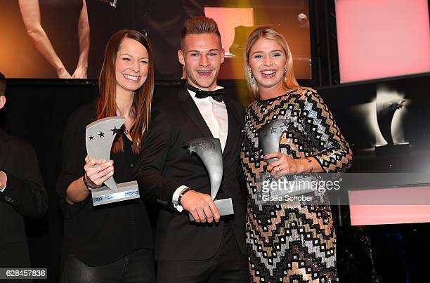 Singer Christina StuermerJoshua Kimmich FC Bayern Muenchen soccer player and Nicole Cross with award during the 10th Audi Generation Award 2016 at...