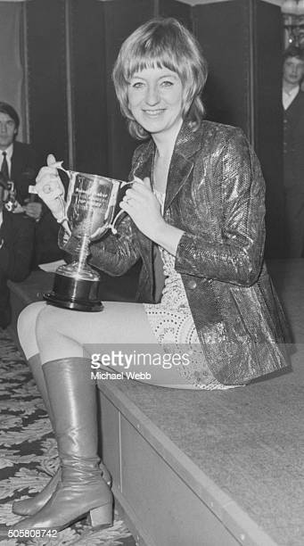 Singer Christine Perfect later known at Christine McVie holding her cup after being voted as Britain's number one girl singer at the Melody Maker pop...