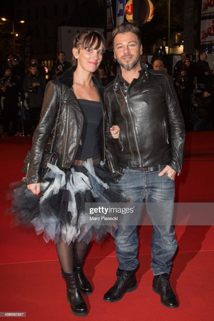 Singer Christophe Mae and wife Nadege Sarron attend the 15th NRJ Music Awards at Palais des Festivals on December 14, 2013 in Cannes, France.