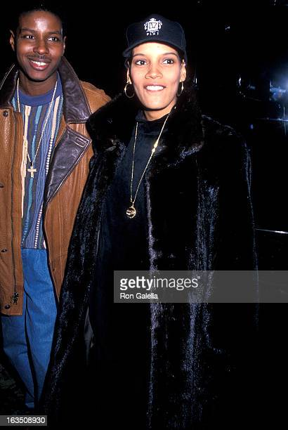 Singer Christopher Martin of Kid 'n' Play and wife actress Shari Headley attend the You So Crazy New York City Premiere on January 31 1994 at the UA...