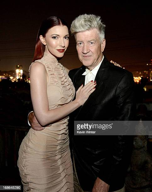 Singer Chrysta Bell and director David Lynch pose before Bell's performance at The Hollywood Forever Cemetery on May 12 2013 in Los Angeles California