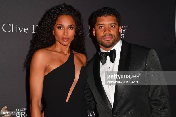 US singer Ciara and Larry Jackson arrive for the traditional Clive Davis party on the eve of the 61th Annual Grammy Awards at the Beverly Hilton...