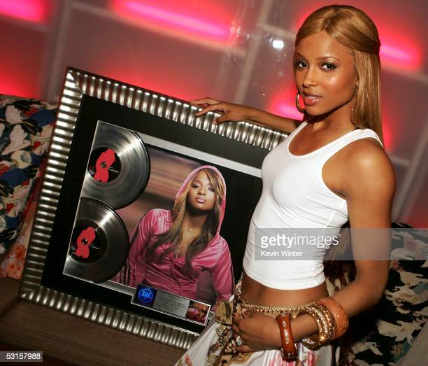 Singer Ciara poses with her double platinum album at the LaFace and AXE present Ciara's BET Awards PreParty and Celebration at Geisha House on June...