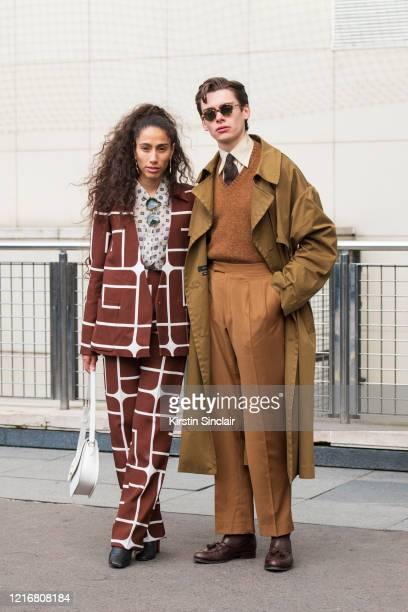 Singer Ciinderella Balthazar wears a Furla bag, Guy Laroche outfit, Kurt Geiger boots and Cerruti shirt with Digital Influencer Mathias Le Fevre...