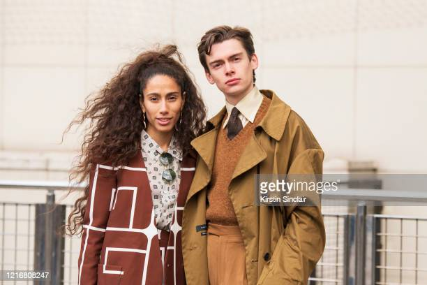 Singer Ciinderella Balthazar wears a Guy Laroche suit and a Cerruti shirt with Digital Influencer Mathias Le Fevre wearing a Qasimi coat, Daks...