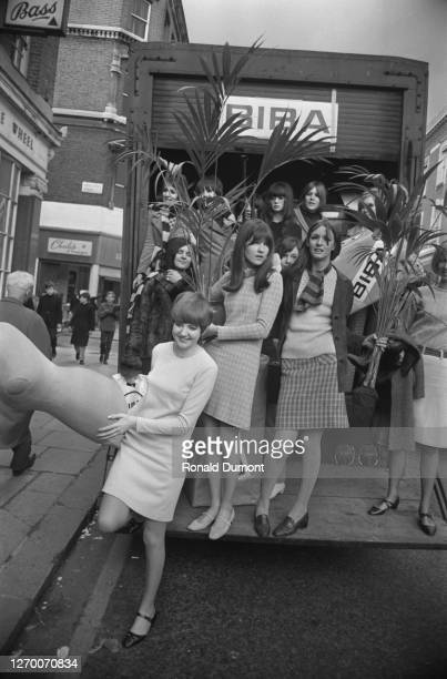 Singer Cilla Black and broadcaster Cathy McGowan among others arrive in a Biba lorry at the new Biba boutique on Kensington Church Street, London,...