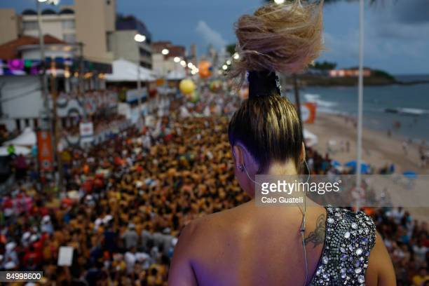 Singer Claudia Leitte performs on a music truck as thousands follow in BarraOndina street carnival track on February 23 2009 in Salvador Brazil