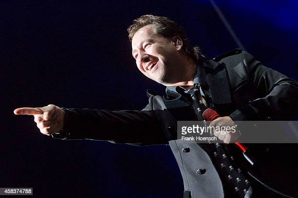 Singer Claudius Dreilich of the German band Karat performs live during the concert Rock Legends at the O2 World on November 1 2014 in Berlin Germany
