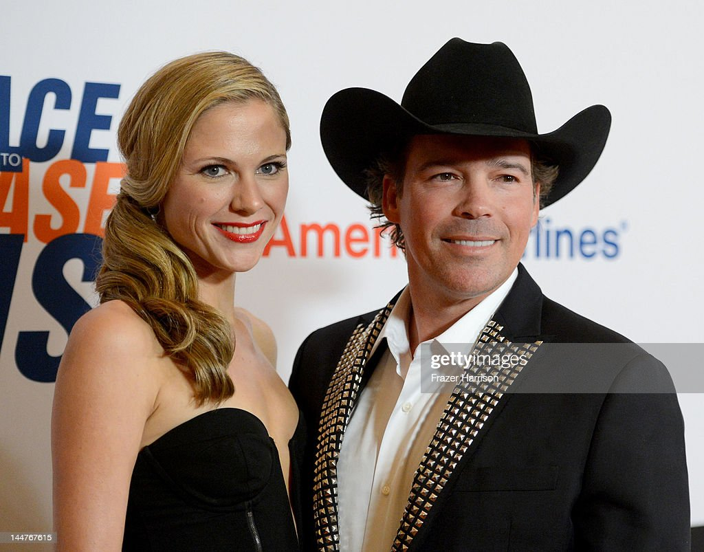 Singer Clay Walker (R) and Jessica Walker arrive at the 19th Annual Race to Erase MS held at the Hyatt Regency Century Plaza on May 18, 2012 in Century City, California.