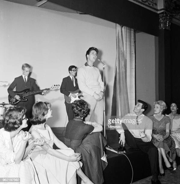 Singer Cliff Richard at the Honey ball, a party to celebrate the launch of 'Honey' magazine. The May Fair Hotel, London. Cliff pictured with his band...