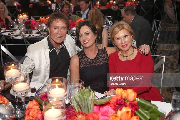 Singer Cliff Richard Dreamland Gala Chairwoman Daryl Stegall and Mireille Strasser Noone attend the Dream Foundation's 2017 Dreamland Gala at The...