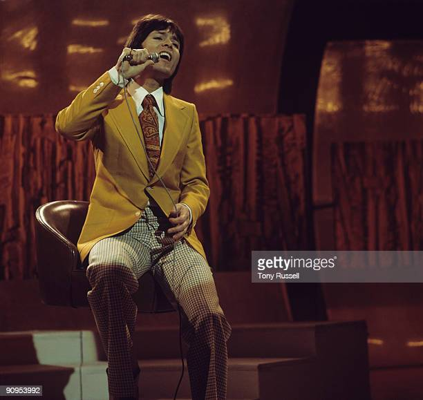 Singer Cliff Richard performs on the Nana Mouskouri television show in March 1974