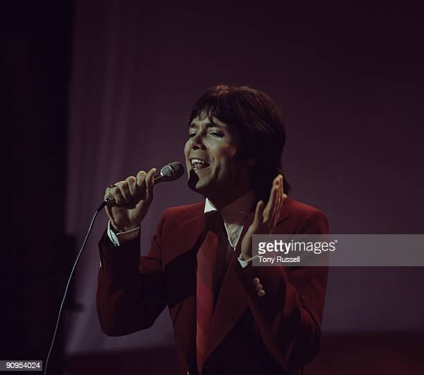 Singer Cliff Richard performs on the Nana Mouskouri television show on February 28 1974