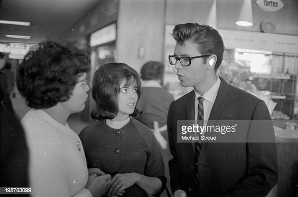 Singer Cliff Richard with his mother Dorothy and one of his sisters May 27th 1964