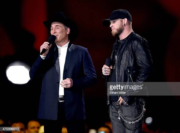 Singer Clint Black and Brantley Gilbert speak onstage during the 50th Academy of Country Music Awards at ATT Stadium on April 19 2015 in Arlington...