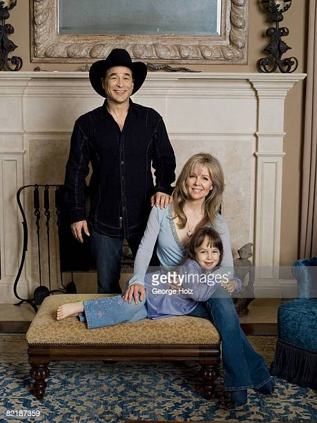 Singer Clint Black poses for a portrait session for People Magazine with his actress/wife Lisa Hartman Black and their daughter Lily on May 1 2008 at...