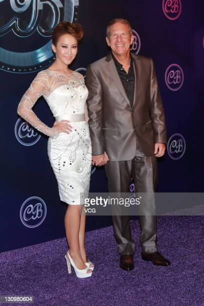Singer Coco Lee and Bruce Rockowitz Chief Executive Officer of Li Fung Ltd during their wedding banquet at Shaw Studio on October 28 2011 in Hong Kong