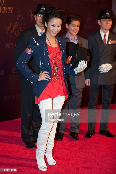 Singer Coco Lee poses for the media wearing a copy of the iconic white rhinestone glove worn by Michael Jackson during the opening ceremony of the MJ...