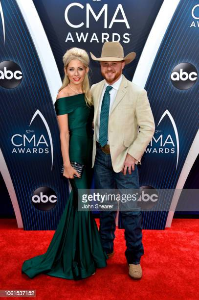 Singer Cody Johnson and Brandi Johnson attend the 52nd annual CMA Awards at the Bridgestone Arena on November 14 2018 in Nashville Tennessee