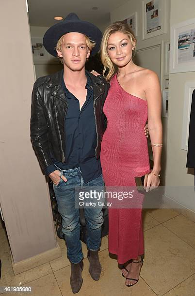 Singer Cody Simpson and honoree/model Gigi Hadid attends The DAILY FRONT ROW 'Fashion Los Angeles Awards' Show at Sunset Tower on January 22 2015 in...