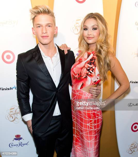 Singer Cody Simpson and model Gigi Hadid attend Sports Illustrated Swimsuit 50th Anniversary Party at Swimsuit Beach House on February 18 2014 in New...