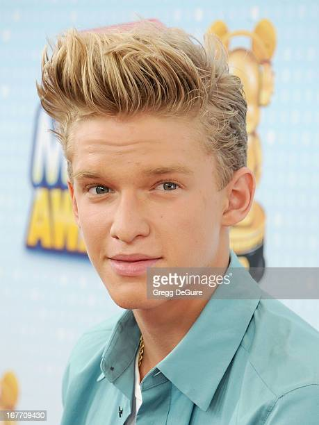 Singer Cody Simpson and sister Alli Simpson arrive at the 2013 Radio Disney Music Awards at Nokia Theatre LA Live on April 27 2013 in Los Angeles...