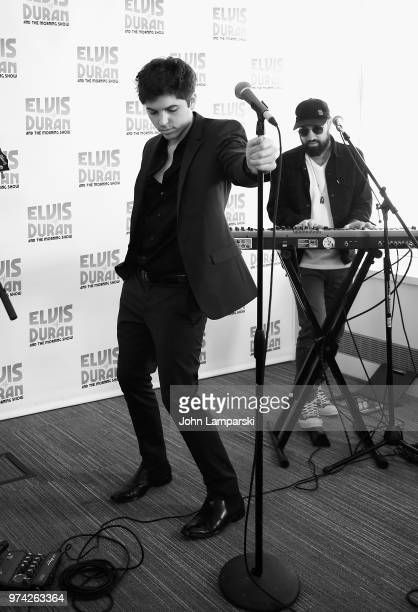 Singer Cole Redding and David Farrell Melton perform during 'The Elvis Duran Z100 Morning Show' at Z100 Studio on June 14 2018 in New York City