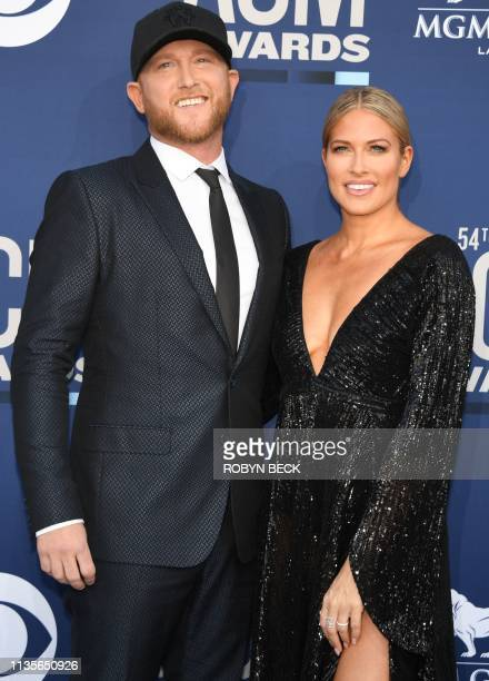 US singer Cole Swindell and US model Barbie Blank arrive for the 54th Academy of Country Music Awards on April 7 at the MGM Grand Garden Arena in Las...
