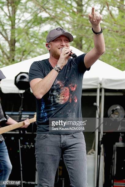 Singer Cole Swindell performs onstage during the ACM Party For A Cause Festival at Globe Life Park in Arlington on April 17 2015 in Arlington Texas