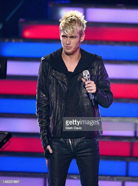 Singer Colton Dixon performs onstage during Fox's American Idol 2012 results show at Nokia Theatre LA Live on May 23 2012 in Los Angeles California