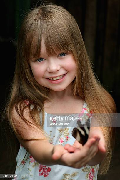 Singer Connie Talbot holds a butterfly as she takes part in a photoshoot at London Zoo on June 25 2009 in London England