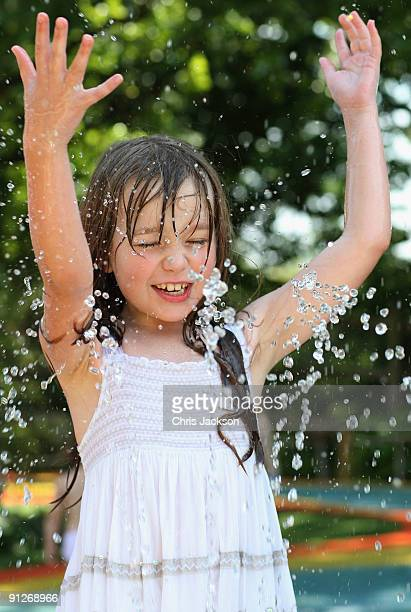 Singer Connie Talbot runs through fountains as she takes part in a photoshoot at London Zoo on June 25 2009 in London England