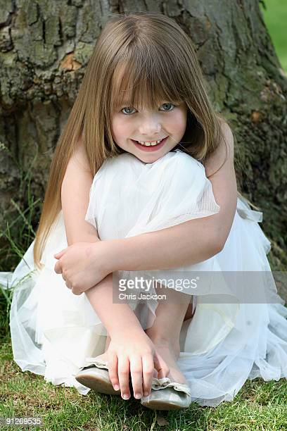 Singer Connie Talbot sits next to a tree as she takes part in a photoshoot at London Zoo on June 25 2009 in London England