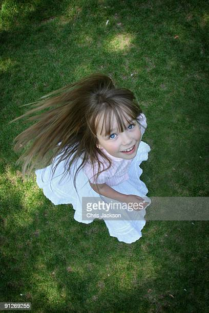 Singer Connie Talbot spins on the grass as she takes part in a photoshoot at London Zoo on June 25 2009 in London England