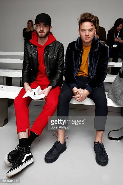 Singer Conor Maynard and guest attend the Bobby Abley show during London Fashion Week Men's January 2017 collections at on January 6 2017 in London...