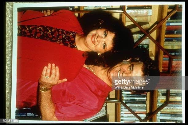 Singer Conway Twitty w. His arm around wife Dee prob. At home.