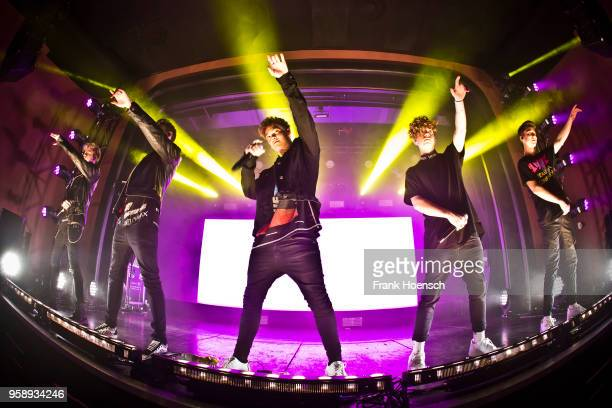 Singer Corbyn Besson Jonah Marais Zach Herron Jack Avery and Daniel Seavey of the American band Why Don't We perform live on stage during a concert...